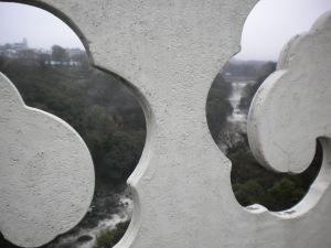 View of Falls Through Decorative Cutout in Bridge